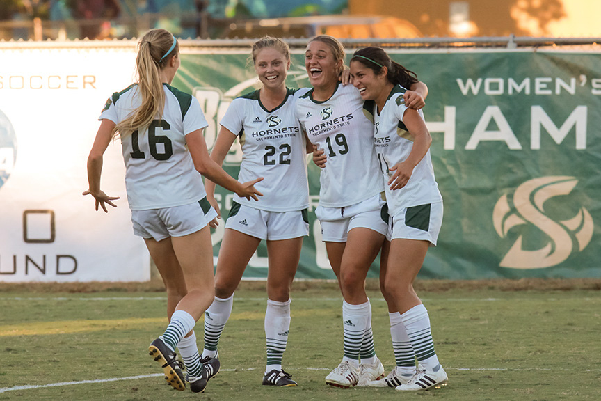Sacramento State senior forward Adaurie Dayak celebrates with her teammates after scoring the game-winning goal against Weber State at Hornet Field on Friday, Oct. 21. (Photo by Matthew Dyer)