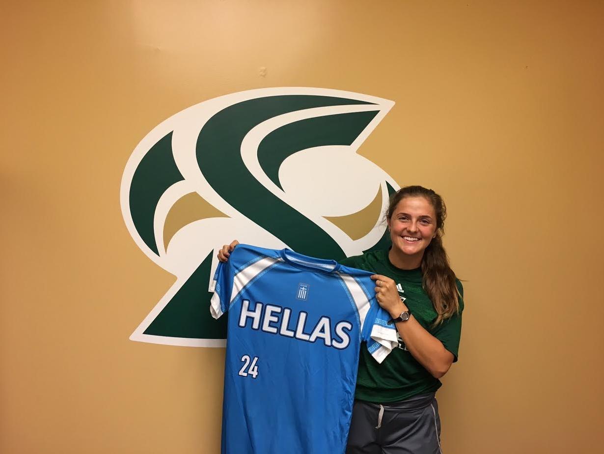Sacramento State senior softball catcher Nikki Gialketsis holds up her Greek national team jersey on Sept. 28, 2016. (Photo by Will Moon)