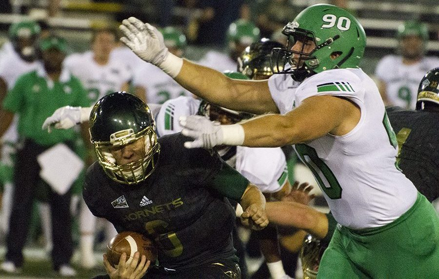 Sacramento State true-sophomore quarterback Nate Ketteringham is sacked by North Dakota defensive lineman Nick Schmitz on Oct. 8 at Hornet Stadium. Ketteringham finished the season completing 165 of his 328 passing attempts for 1,977 yards, 13 touchdowns and 12 interceptions. (Photo by Michael Zhang)