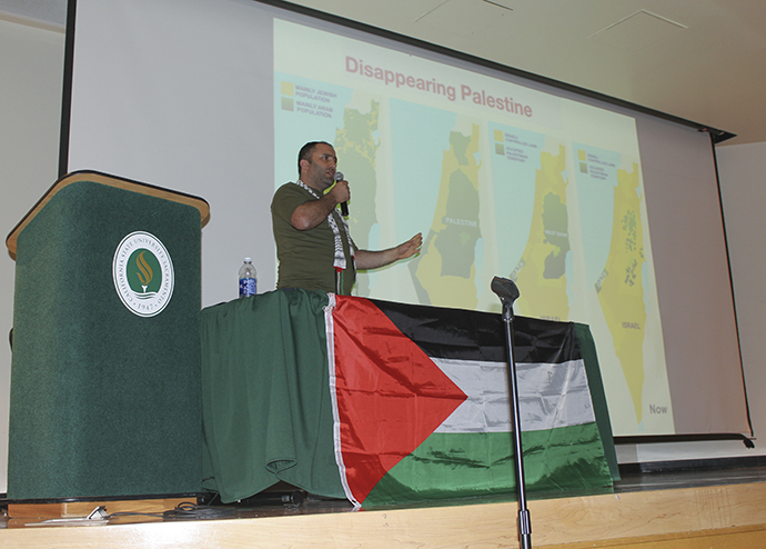 Activist+Issa+Amor+speaks+in+the+Hinde+Auditorium+at+Sacramento+State+on+Wednesday+night+about+the+what+is+currently+occurring+in+the+Palestinian+territories.+He+was+invited+by+Students+for+Justice+in+Palestine%2C+an+organization+on+campus.+%28Photo+by+Paola+Lupercio%29