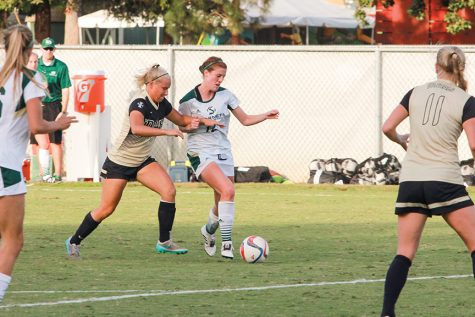 Junior forward Kayla Collins fights off an Idaho defender at Hornet Field on Friday, Oct 7. (Photo by Matthew Dyer)