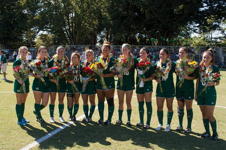 Sacramento State seniors pose for a picture on senior day before defeating Idaho State 2-1 at Hornet Field on Sunday, Oct. 9. (Photo by Matthew Dyer)