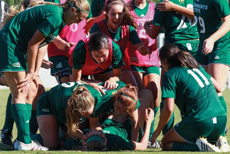 Sacramento State senior Kassidy Kellogg celebrates with her teammates after scoring the game-winning goal against Idaho State at Hornet Field on Sunday, Oct. 9. (Photo by Matthew Dyer)