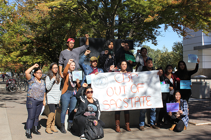 Students pose for a picture in front of the University Union on Thursday, Oct. 20, 2016 as they protest reports that US Customs and Border Protection visited Sac State (Photo by Paola Lupercio).