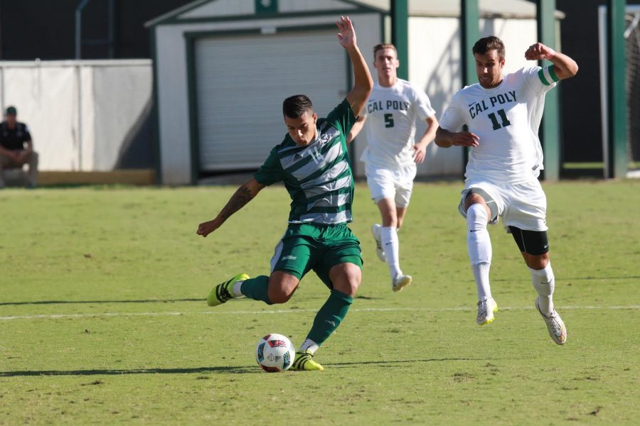 Sacramento State junior forward Cylus Sandoval prepares to pass the ball against Cal Poly at Hornet Field on Wednesday, Oct. 19. (Photo by Matthew Dyer)