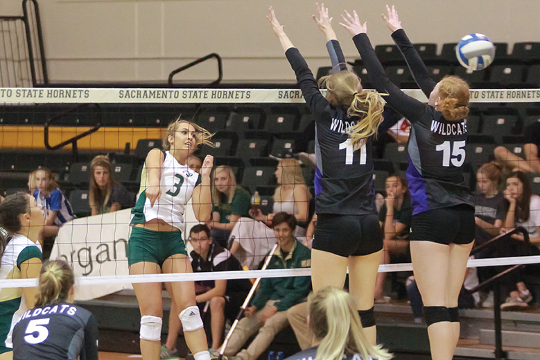 Sacramento+State+senior+outside+hitter+Morgan+Stanley+spikes+the+ball+past+Hannah+Hill+and+Amanda+Varley+of+Weber+State+at+Colberg+Court+on+Saturday%2C+Nov.+12+%28Photo+by+Matthew+Dyer%29