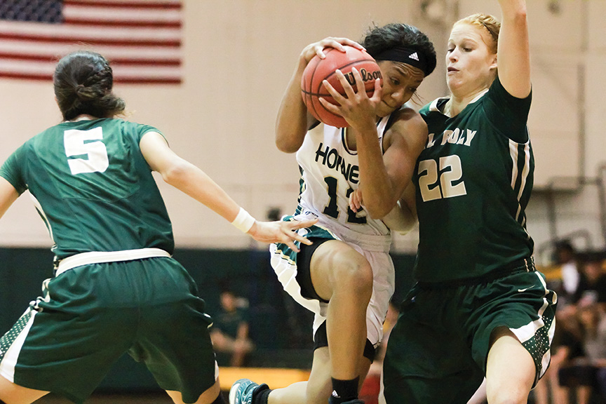 Sacramento State senior guard Ashlyn Crenshaw drives into the lane for a layup against Mary Kate Evans of Cal Poly at the Hornets Nest on Sunday, Nov. 13. (Photo by Matthew Dyer)