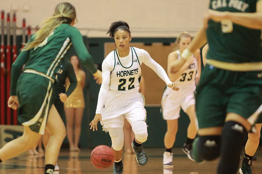 Sacramento State junior guard Maranne Johnson dribbles down the court against Cal Poly at the Hornets Nest on Sunday, Nov. 13. (Photo by Matthew Dyer)