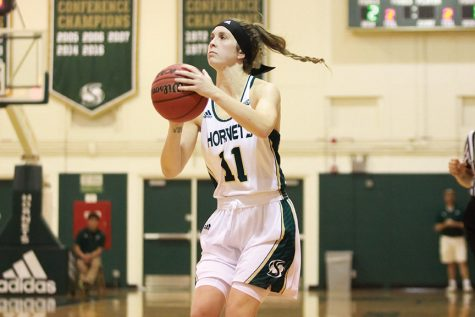 Sacramento State senior guard Emily Easom shoots a three pointer against Cal Poly at the Hornets Nest on Sunday, Nov. 13. (Photo by Matthew Dyer)