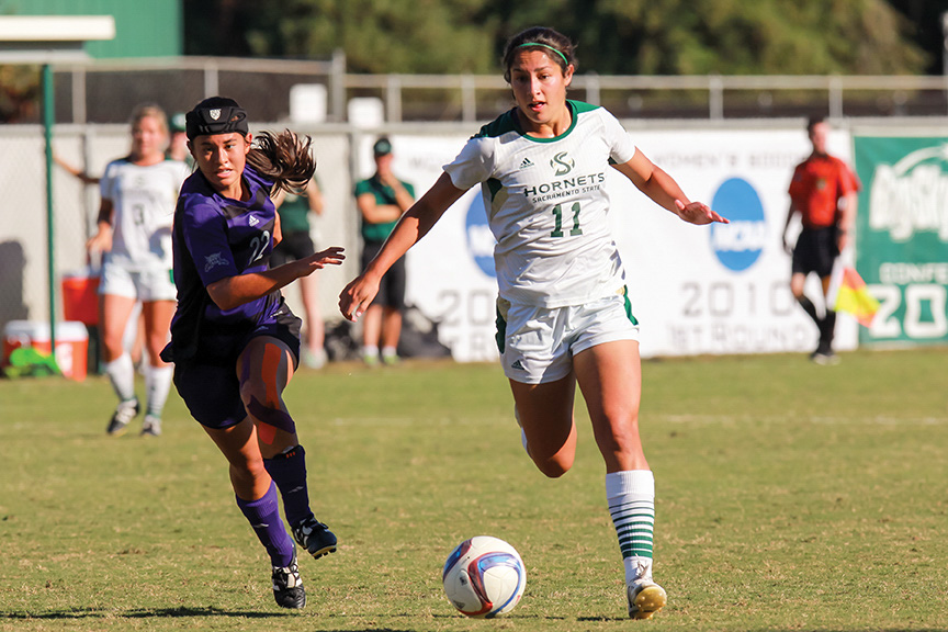 Sacramento State senior forward Jennifer Lum dribbles the ball past Amy Chidester of Weber State at Hornet Field on Oct. 21. Lum was named to the all-Big Sky first team after leading Sac State with six goals and 36 shots on goal. (Photo by Matthew Dyer)