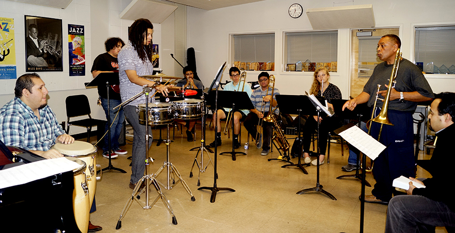 Members of the Latin Jazz Ensemble rehearsal for their Nov. 29 concert inside Capistrano Hall. (Photo by Marivel Guzman)