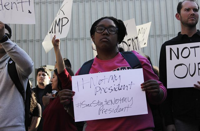 Sac State student Ashley Goins protests the election of Donald J. Trump at the Library Quad on Nov. 9, 2016.