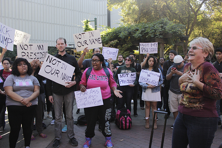 Sac State student Ashley Goins, center, protests the election of Donald J. Trump at the Library Quad on Nov. 9, 2016.