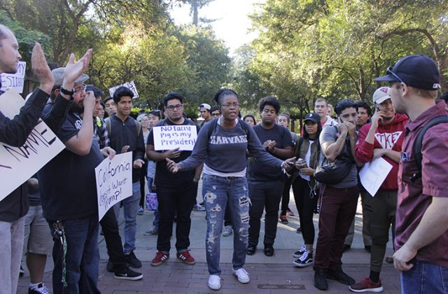 """Sac State student Donna Colbert asks students to """"stay involved"""" during an anti-Trump protest in the Library Quad on Nov. 9, 2016."""