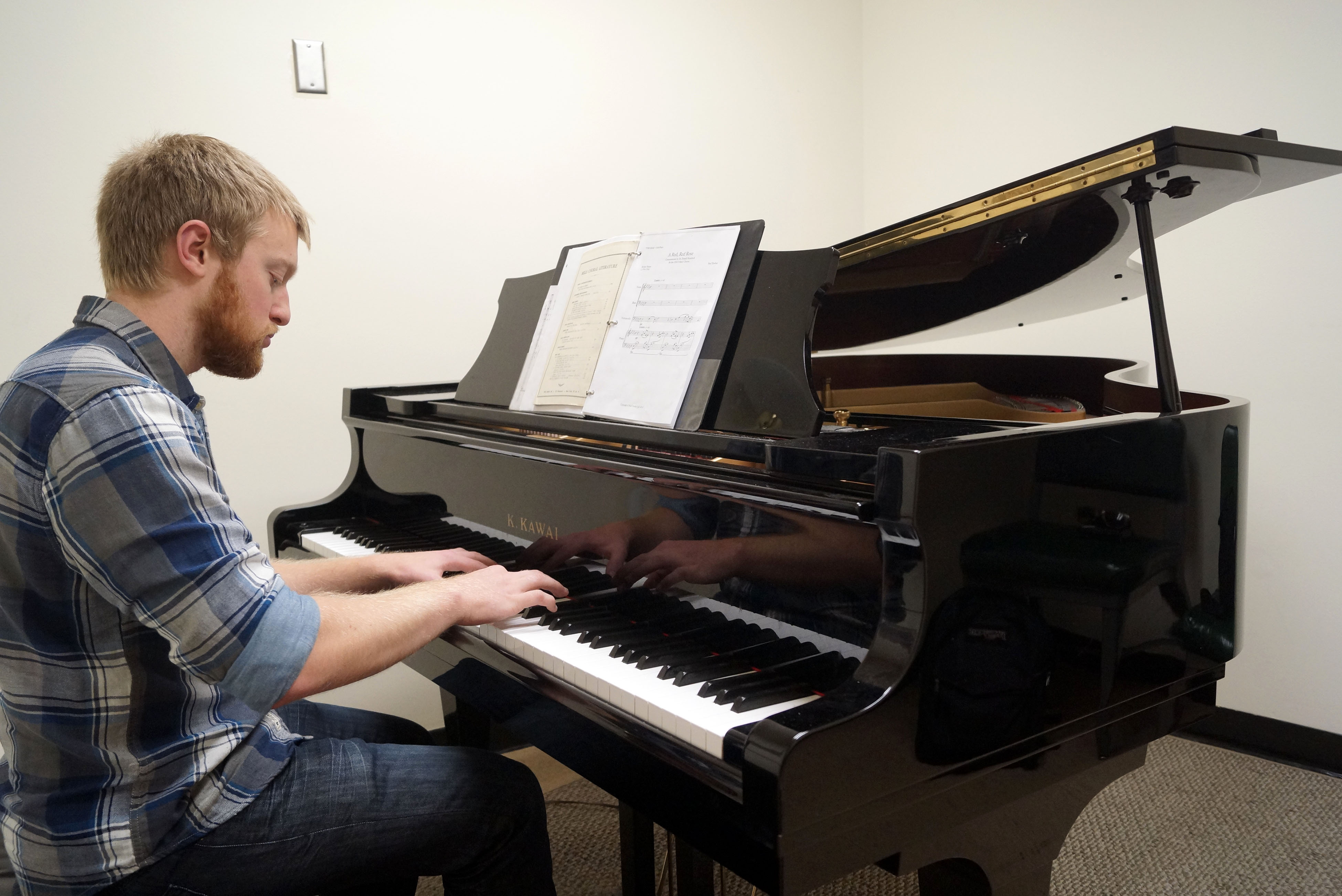 Junior music major Paul Towber, 23, rehearses his composition 'A Red, Red Rose,' which is inspired by a poem of Robert Burns. Towber will be conducting his piece at the
