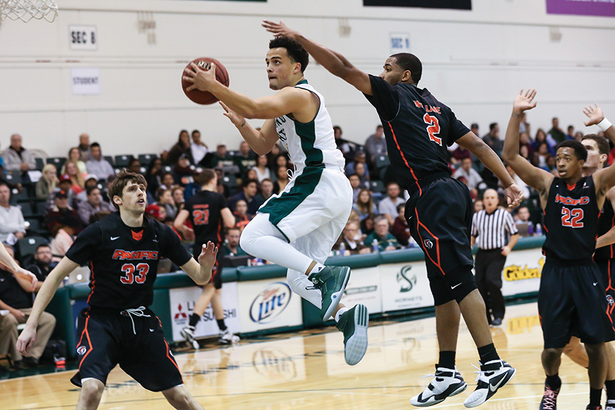 Sacramento State junior guard Marcus Graves attempts a layup in the paint against the University of the Pacific in the Sacramento State Invitational on Nov. 29, 2016 in the Hornets Nest. (Photo by Francisco Medina)