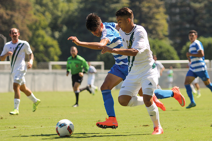Sacramento State senior forward Alex Bettencourt dribbles the ball past a San Jose State defender at Hornet Field on Sept. 18. (Photo by Matthew Dyer)