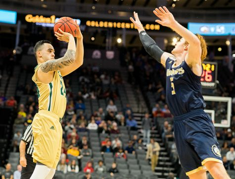 Sacramento State true-freshman guard Izayah Mauriohooho-Le'afa attempts a 3-pointer over Siler Schneider of UC Davis at Golden 1 Center on Monday, Nov. 21. (Photo by Michael Zhang)