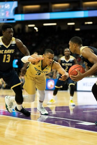 Sacramento State junior forward Justin Strings attempts to steal the ball away from Brynton Lemar of UC Davis at Golden 1 Center on Monday, Nov. 21. (Photo by Michael Zhang)