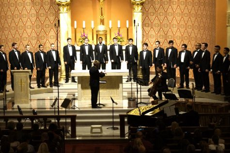 Paul Towber conducts the men's chorus at the Music from Heaven and Earth Choral concert at the Sacred Heart Church, Saturday, Nov. 5. (Photo by Marivel Guzman)