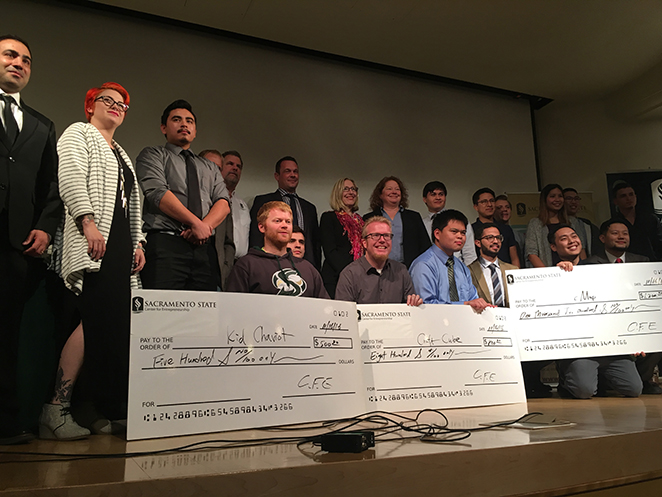 The winners of 'The Pitch' competition stand on-stage at the conclusion of the competition on Wednesday, Nov. 16 in Sacramento State's Hinde Auditorium. (Photo by Rin Carbin)