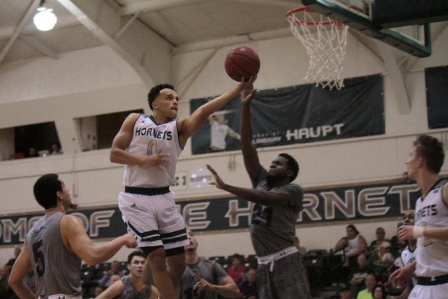 Sacramento State junior guard Marcus Graves attempts a layup against an Antelope Valley defender on Thursday at the Hornets Nest. Graves finished with a team-high 19 points in the Hornets' 82-60 win. (Photo by Bryce Fraser)