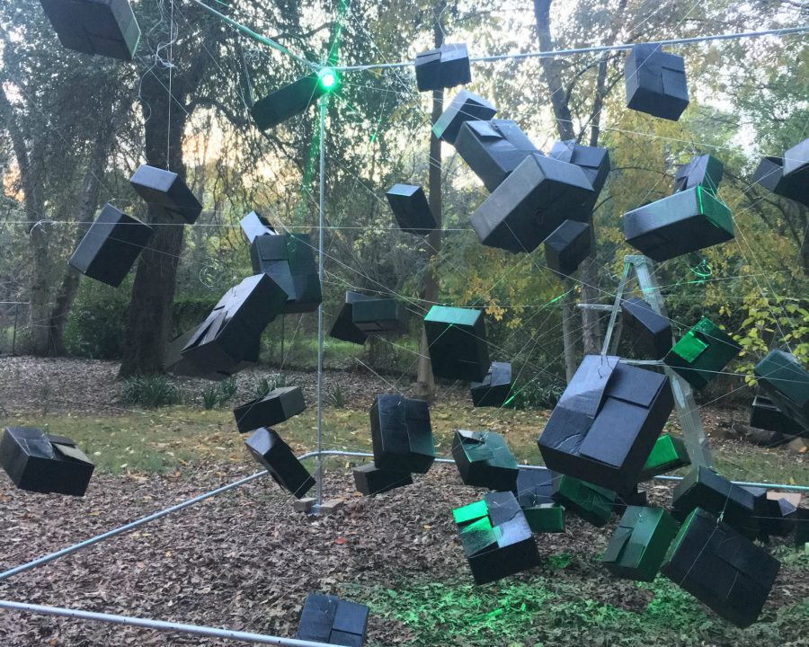 Senior art major Tammy Helenskes elaborate set for her performance at show entitled Barmecidal Banquet: An Illusionary Feast of Dreams at the Sacramento State University Arboretum on Wednesday night. (Photo by Edrian Pamintuan)
