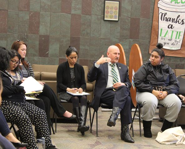 Sacramento State President Robert Nelsen, center, listens to students voice their concerns about campus diversity at a forum in the Multi-Cultural Center on Friday, Dec. 9. This Monday, Nelsen sent out a message on SacSend asking students to avoid the term 'illegal' in reference to undocumented students. (Photo by Rin Carbin)