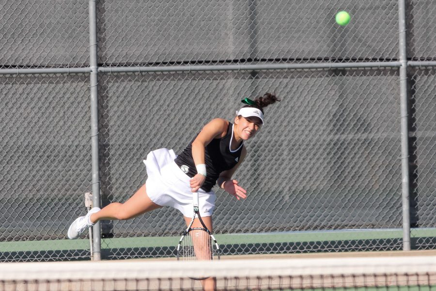 Sacramento+State+junior+Ana+Loaiza+Esquivias+serves+the+ball+to+Kristy+Jorgensen+of+UC+Davis+during+a+singles+match+at+the+Sacramento+State+Tennis+Courts%2C+Jan.+28.+%28Photo+by+Matthew+Dyer%29