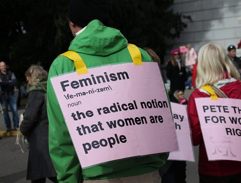 Demonstrators wear printed signs in support of women's rights at the Women's March on Sacramento at the State Capitol on Saturday, Jan. 21, 2016. (Photo by Barbara Harvey)