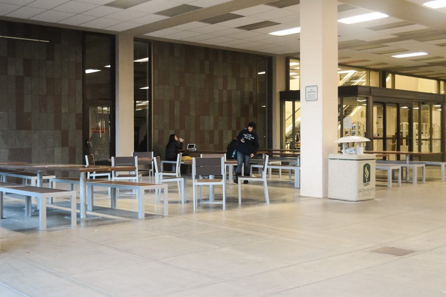 The Library installs 49 permanent sets of tables and chairs in the breezeway in December 2016. (Photo by Matthew Dyer)