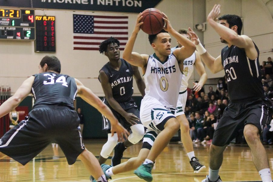 Sacramento State junior guard Marcus Graves drives past several Montana defenders for a layup at the Nest, Saturday, Jan. 21.  Graves had 18 points and a career-high 13 assists to help the Hornets to a 92-83 win. (Photo by Matthew Dyer)