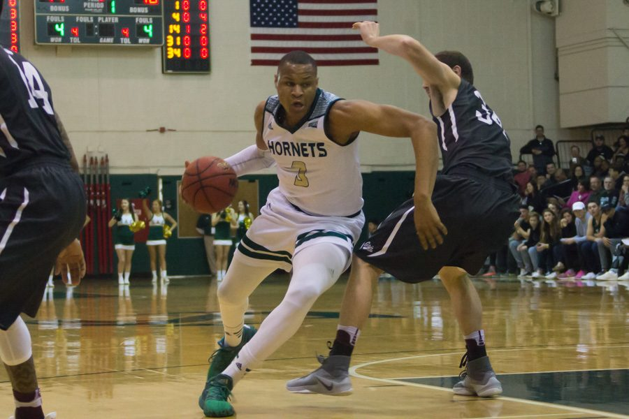 Sacramento State senior forward Justin Strings drives past Brandon Gfeller of Montana for a layup in the paint during a 92-83 win Jan. 21 at the Nest. Strings led the Hornets with a game-high 44 points in a 94-75 win against UC Santa Cruz in their lone exhibition game of the 2017-18 season Friday at the Nest.