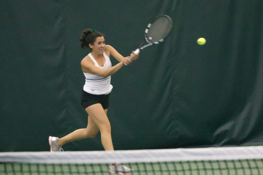 Sacramento State junior Ana Loaiza Esquivias backhands the ball for a point in her singles match against Galina Bykova of Fresno State at Spare Time Indoor Tennis Center, Sunday, Jan. 22. (Photo by Matthew Dyer)