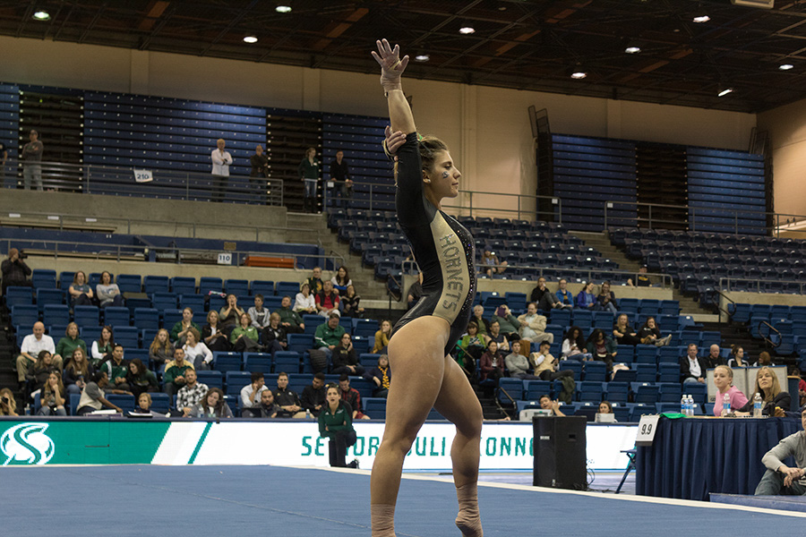 Sacramento State senior gymnast Julia Konner prepares to begin her floor exercise at the 40th Anniversary Causeway Classic on Sunday in the Pavilion at UC Davis. Konner placed sixth on floor with a score of 9.775. (Photo by Matthew Nobert)