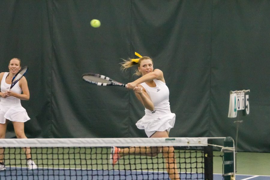 Sacramento State freshman Carolina Chernyetsky hits the ball in a doubles match with senior teammate Andie Mouzes against the University of San Francisco at Spare Time Indoor Tennis Center on Jan. 20. (Photo by Matthew Dyer)