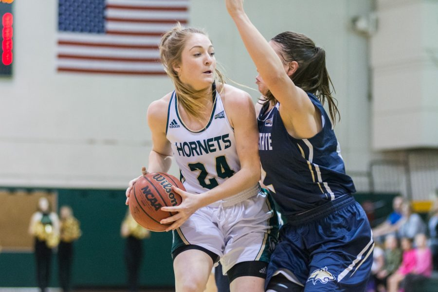 Sacramento State senior forward Gretchen Harrigan backs down a Montana State defender in the post Saturday at the Nest. (Photo by Matthew Dyer)