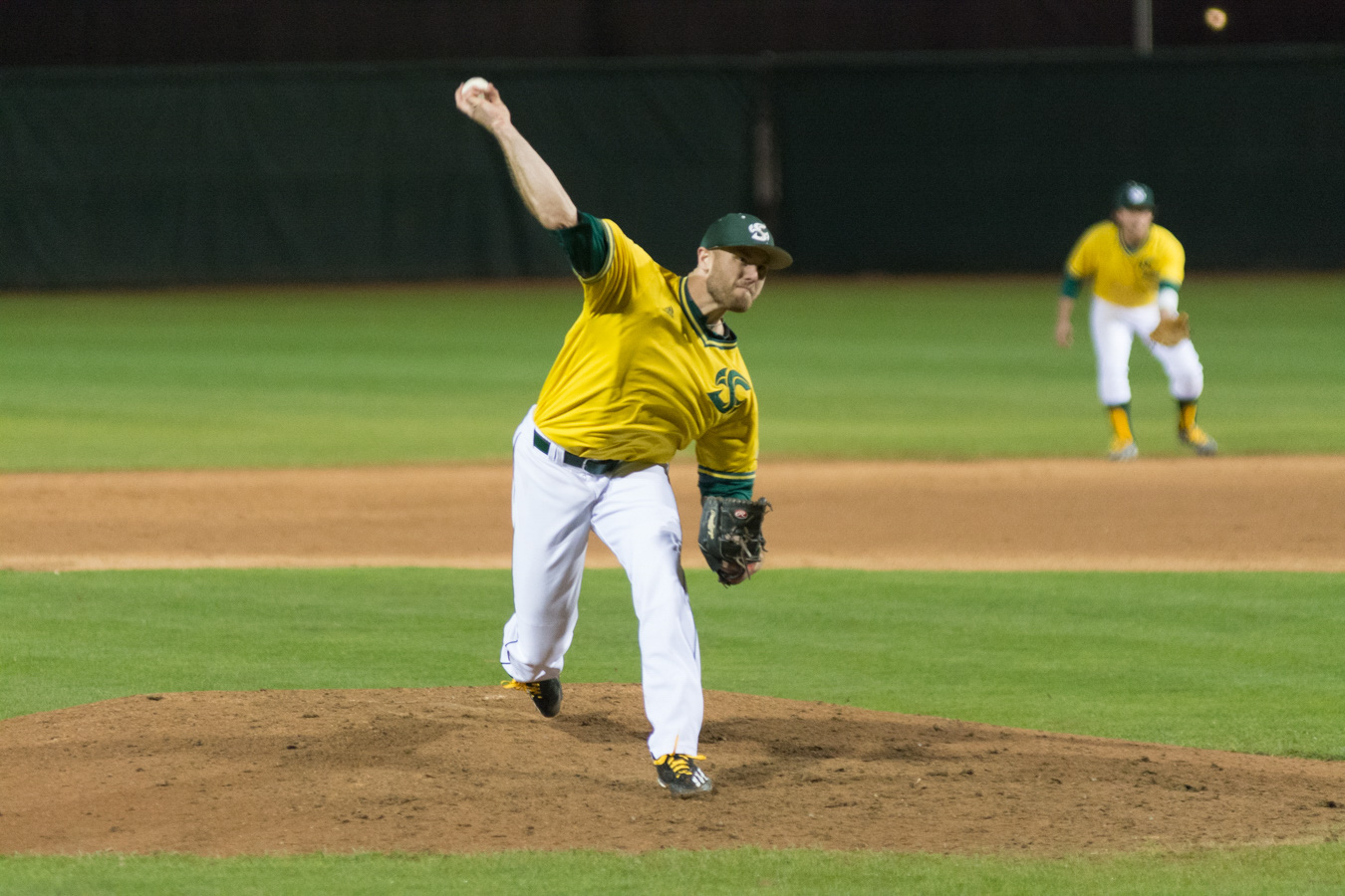 Sacramento State right-handed senior pitcher Justin Dillon pitches the ball towards home plate for the final out of a no-hitter against Northern Kentucky at John Smith Field on Feb. 23. (Photo by Matthew Dyer)