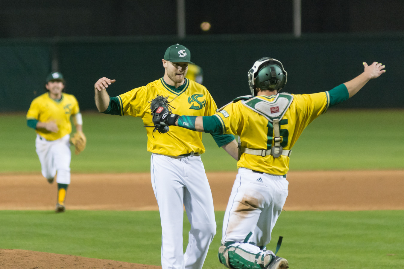 Sacramento State right-handed senior pitcher Justin Dillon celebrates with freshman catcher Dawsen Bacho after throwing a no-hitter against Northern Kentucky at John Smith Field on Feb. 23. (Photo by Matthew Dyer)
