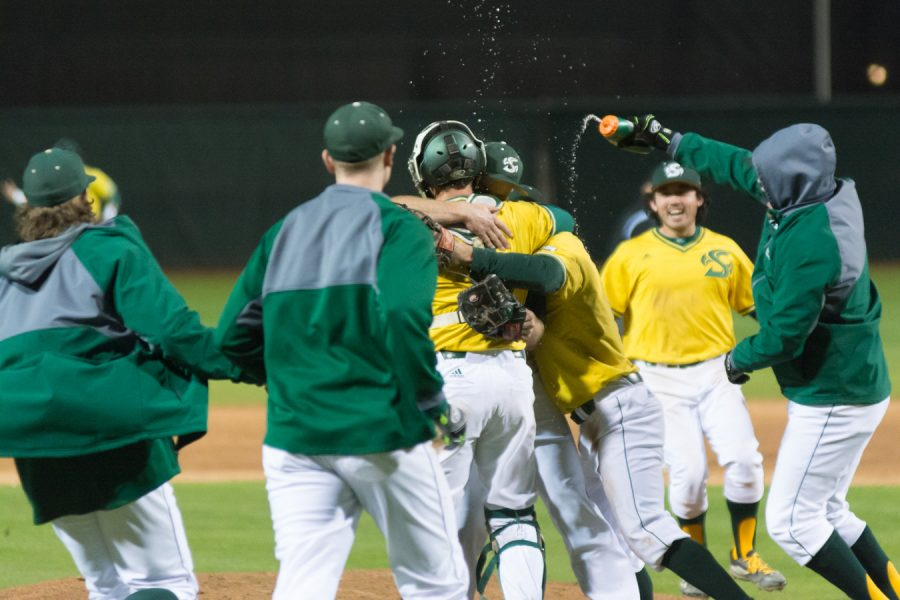 Sacramento State senior right-handed pitcher Justin Dillon celebrates with teammates after throwing the Hornets' first no-hitter in Division I history against Northern Kentucky at John Smith Field on Thursday. (Photo by Matthew Dyer)