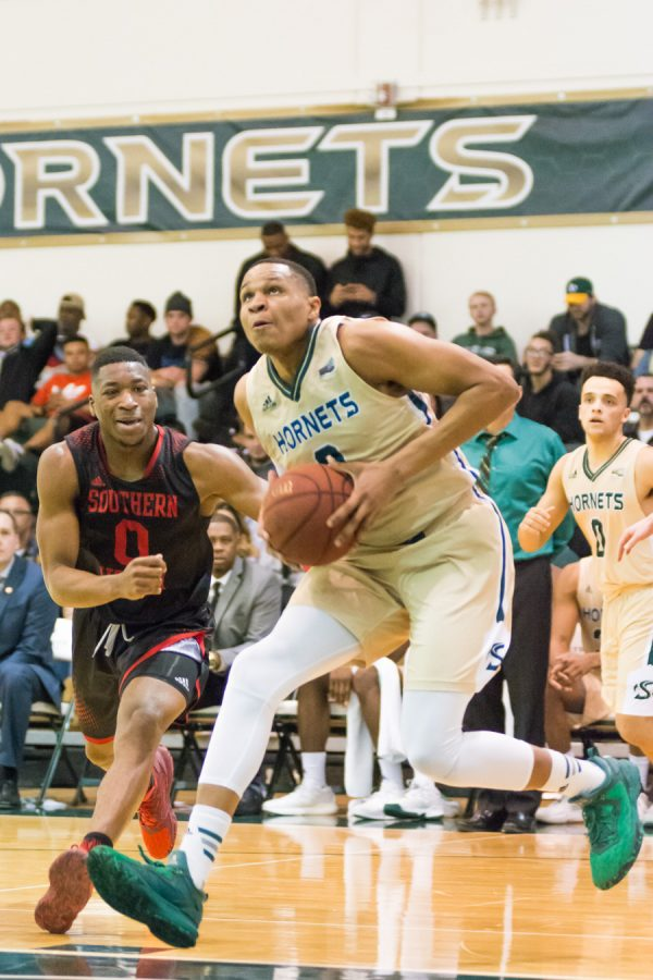 Sacramento State junior forward Justin Strings goes up for a layup against Southern Utah Saturday at the Nest. (Photo by Matthew Dyer)