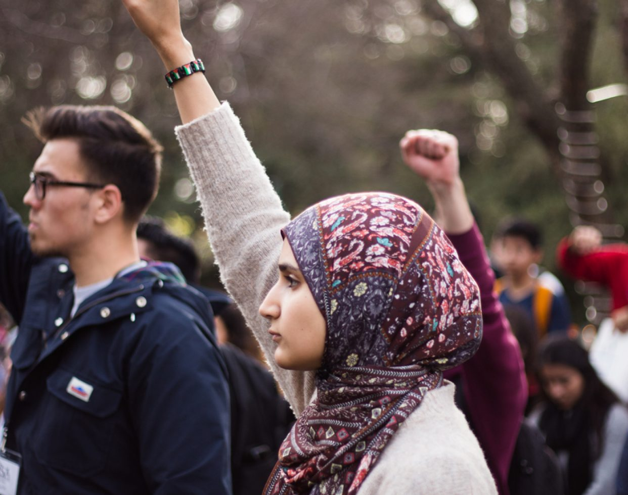Demonstrators march through the Sacramento State campus during a #NoBanNoWall protest on Feb. 2, 2017. An estimated 300 people attended.