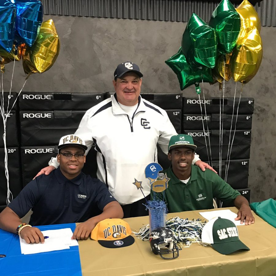 Central+Catholic+High+School+seniors+Montell+and+DaRon+Bland%2C+with+high+school+football+coach+Roger+Canepa+by+their+side%2C+signed+their+letter+of+intent+on+Feb.+1+to+attend+UC+Davis+and+Sacramento+State%2C+respectively%2C+in+the+fall+of+2017.+%28Photo+courtesy+of+Brett+Butler%2FThe+Performance+Lab%29