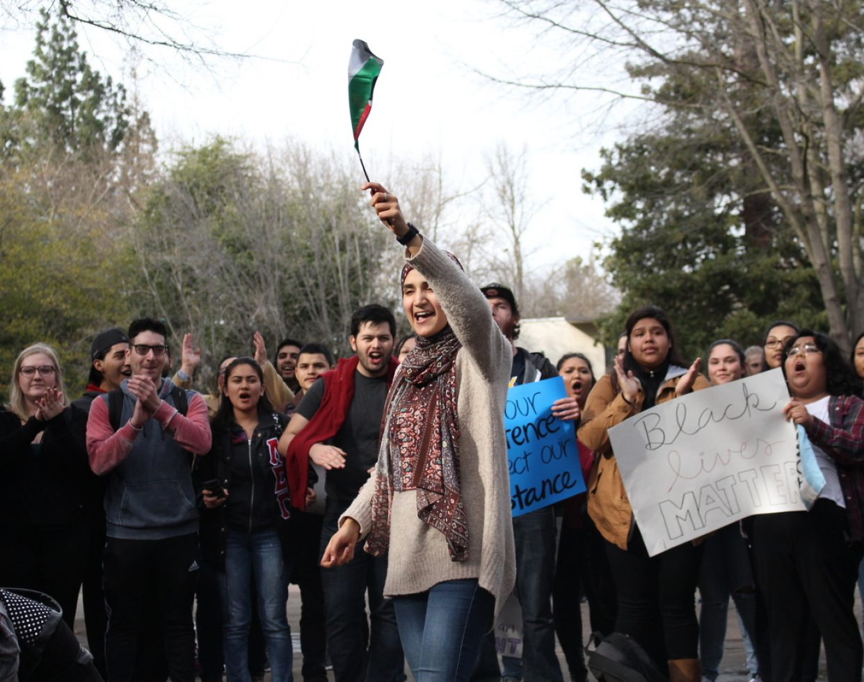 Demonstrators marched through the Sacramento State campus during a #NoBanNoWall protest on Feb. 2, 2017. An estimated 300 people attended.