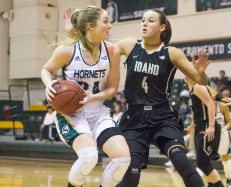 Sacramento State senior forward Gretchen Harrigan spins away from Brooke Reilly of Idaho at the Nest on Saturday.  Harrigan had a game-high 23 points, five rebounds and two assists in a 72-58 loss. (Photo by Matthew Dyer)