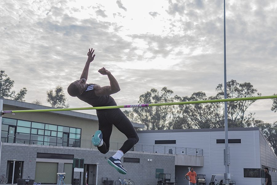 Sacramento State junior jumper Darius Armstead practices his high jump during practice on Feb. 15 at Hornet Stadium. Armstead is on the four-man squad of Sac State jumpers that finished the indoor season ranked fourth in the NCAA for track and field. (Photo by Matthew Nobert)