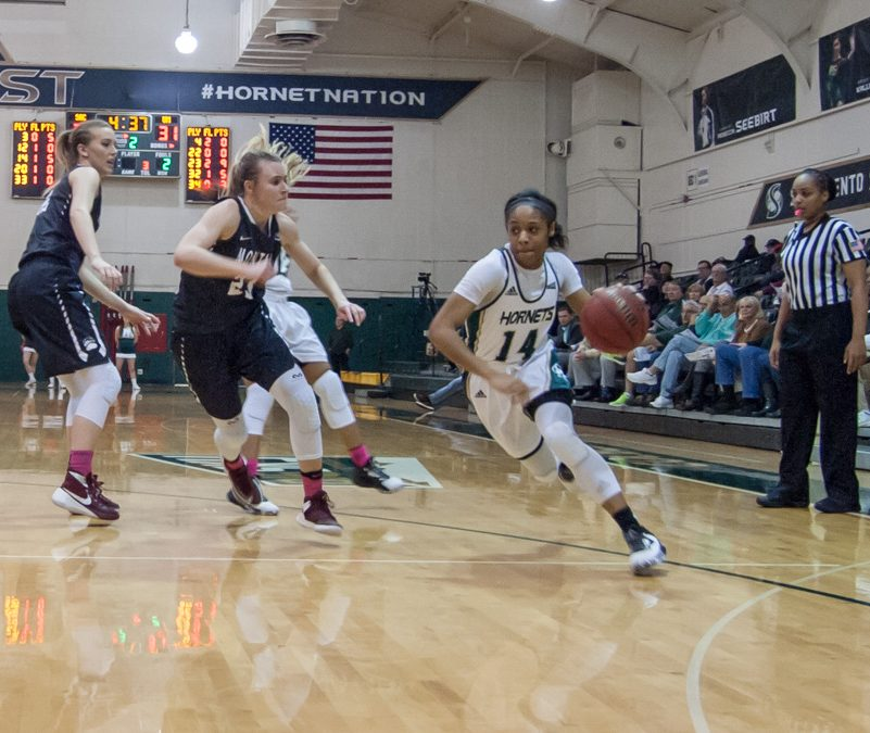 Sacramento State freshman guard Quayonna Harris dribbles the ball against Montana at the Nest on Feb. 16. (Photo by Andro Palting)