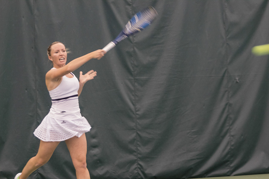 Sacramento State senior Andie Mouzes returns the ball  against Northern Arizona at Spare Time Indoor Tennis Center Saturday. (Photo by Matthew Nobert)