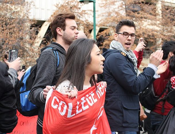 Members of the Sacramento State College Republicans, left, chant 'build the wall, protect us all' while Amer Tere, right, the vice president of the Muslim Student Association, directs the 'no ban, no wall' protesters to move around them at Sac State on Feb. 2. The College Republicans have pressed charges against a protester for allegedly assaulting one of their members. (Photo by Barbara Harvey)