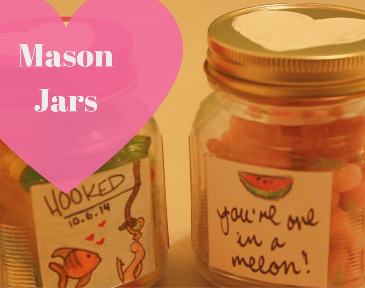 "Fill a few mason jars with candy, paint designs on the lid (like a heart) and paste a handwritten message on the bottle. Get creative and pair your candy with punny messages like, ""love you to pieces"" on a jar of Reese's pieces or ""life without you would be unbearable"" on a jar of gummy bears.  (Photo: Sami Soto)"